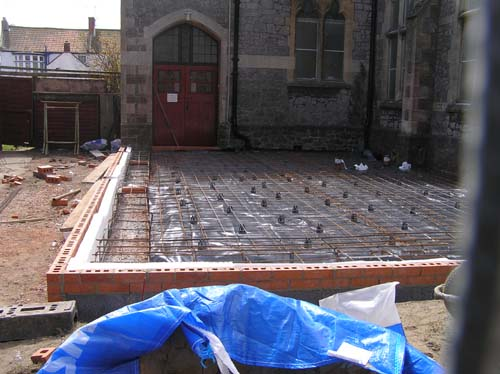 10/4 The steelwork for the floor and the first couple of courses of bricks have been laid.